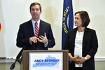 FILE - In this Nov. 14, 2019, file photo, Kentucky Gov.-elect Andy Beshear, left, with Lt. Gov.-elect Jacqueline Coleman, speaks with reporters following the concession of incumbent Gov. Matt Bevin in Frankfort, Ky. It's a role that seems scripted for Coleman, as an educator transitioning to the job as a