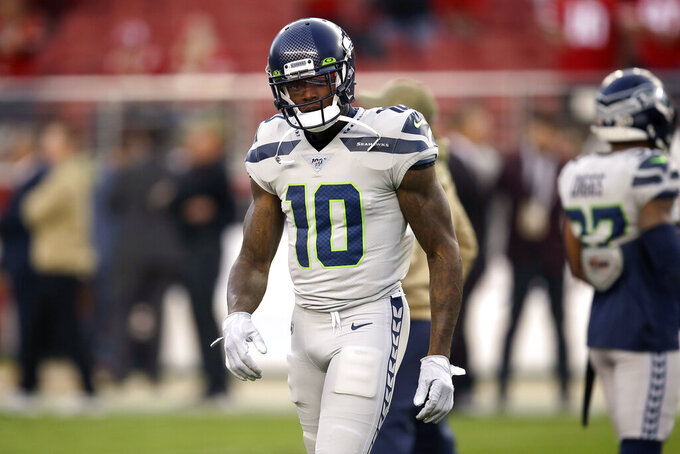 FILE - Seattle Seahawks wide receiver Josh Gordon warms up before an NFL football game against the San Francisco 49ers in Santa Clara, Calif., in this Monday, Nov. 11, 2019, file photo. Josh Gordon was conditionally reinstated by the NFL on Thursday, Dec. 3, 2020, and can begin the process of joining the Seattle Seahawks' roster as early as Friday. Commissioner Roger Goodell reinstated Gordon after nearly a one-year suspension following his latest off-field transgression for violations of the league's substance abuse policies. (AP Photo/Ben Margot, File)
