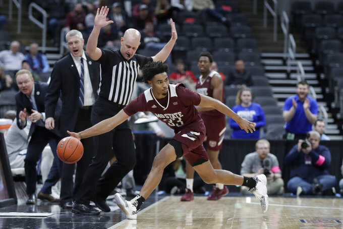 Missouri State's Josh Hall reaches for a ball as it goes out of bounds during the first half of an NCAA college basketball game against Indiana State in the quarterfinal round of the Missouri Valley Conference men's tournament Friday, March 6, 2020, in St. Louis. (AP Photo/Jeff Roberson)