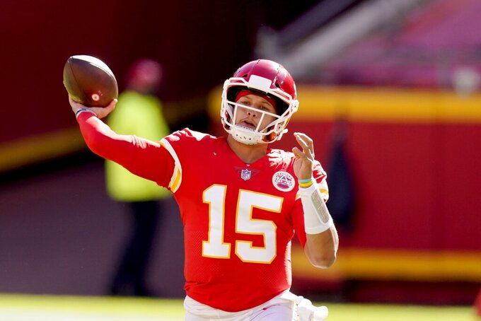 Kansas City Chiefs quarterback Patrick Mahomes (15) throws a pass to Tyreek Hill for a touchdown in the first half of an NFL football game against the New York Jets on Sunday, Nov. 1, 2020, in Kansas City, Mo. (AP Photo/Charlie Riedel)