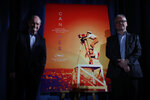 Festival director Thierry Fremaux, right, and festival president Pierre Lescure pose in front of the Cannes International Film Festival poster for the upcoming 72nd edition during a press conference to announce this years line up in Paris, Thursday April 18, 2019. The festival will run from May 14 to May 25, 2019. (AP Photo/Francois Mori)