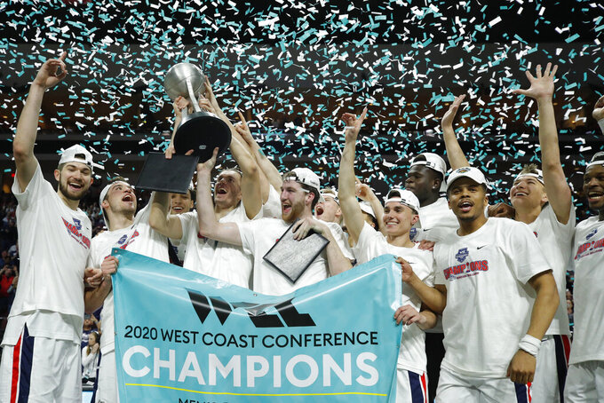 Gonzaga players celebrate after defeating Saint Mary's in an NCAA college basketball game in the final of the West Coast Conference men's tournament Tuesday, March 10, 2020, in Las Vegas. (AP Photo/John Locher)