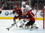 Arizona Coyotes goaltender Antti Raanta (32) makes a save on New York Islanders right wing Jordan Eberle in the first period of an NHL hockey game, Monday, Feb. 17, 2020, in Glendale, Ariz. (AP Photo/Rick Scuteri)