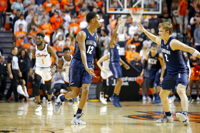 Georgetown's Terrell Allen (12) and Mac McClung (2) celebrate after Allen made a basket against Oklahoma State during an NCAA college basketball game in Stillwater, Okla., Wednesday, Dec. 4, 2019. (Bryan Terry/The Oklahoman via AP)