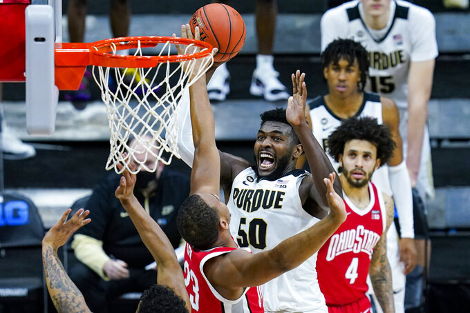 Purdue forward Trevion Williams (50) shoots over Ohio State forward Zed Key (23) in the second half of an NCAA college basketball game at the Big Ten Conference tournament in Indianapolis, Friday, March 12, 2021. (AP Photo/Michael Conroy)