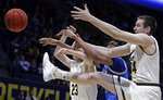 California's Connor Vanover (23), UCLA's Moses Brown, center, and California's Jacobi Gordon (24) reach for a loose ball during the first half of an NCAA college basketball game Wednesday, Feb. 13, 2019, in Berkeley, Calif. (AP Photo/Ben Margot)
