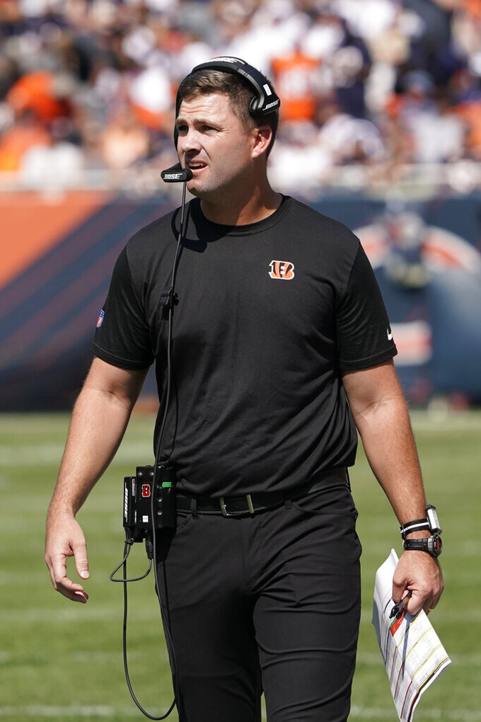 Cincinnati Bengals head coach Zac Taylor walks the sidelines during the first half of an NFL football game against the Chicago Bears Sunday, Sept. 19, 2021, in Chicago. (AP Photo/David Banks)