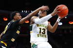 Wright State guard Malachi Smith (13) drives on Northern Kentucky guard Jalen Tate (11) during the first half of an NCAA college basketball game for the Horizon League men's tournament championship in Detroit, Tuesday, March 12, 2019. (AP Photo/Paul Sancya)