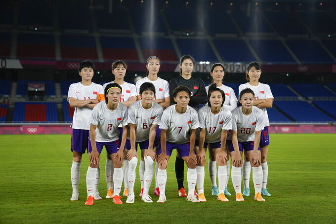 China starting players pose for a photo prior to a women's soccer match against Netherlands at the 2020 Summer Olympics, Tuesday, July 27, 2021, in Yokohama, Japan. (AP Photo/Kiichiro Sato)