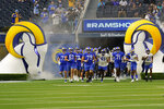 Fans watch as the Los Angeles Rams enter the field during NFL football camp Thursday, June 10, 2021, in Inglewood, Calif. (AP Photo/Marcio Jose Sanchez)