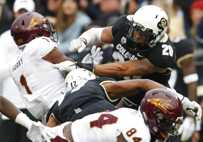 Colorado linebacker Drew Lewis, right, hits Arizona State punt returner N'Keal Harry in the second half of an NCAA college football game Saturday, Oct. 6, 2018, in Boulder, Colo. Colorado won 28-21. (AP Photo/David Zalubowski)