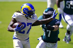 Los Angeles Rams' Darrell Henderson runs against Philadelphia Eagles' Nate Gerry during the first half of an NFL football game, Sunday, Sept. 20, 2020, in Philadelphia. (AP Photo/Chris Szagola)