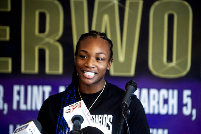 FILE - Boxers Claressa Shields speaks during a news conference ahead of a women's super welterweight title fight against Eve Dicaire in Flint, Mich., in this Wednesday, March 3, 2021, file photo. Two-time Olympic boxing gold medalist Claressa Shields has a date and an opponent for her mixed martial arts debut with the Professional Fighters League. Shields will fight Brittney Elkin on June 10, the promotion told The Associated Press on Wednesday, April 14, 2021. (Jake May/The Flint Journal via AP, File)