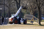 FILE - In this Jan. 7, 2021, file photo, crew remove a scaffolding near the U.S. Capitol that had a noose hanging from it the day before in Washington. Both within and outside the walls of the Capitol, banners and symbols of white supremacy and anti-government extremism were displayed as an insurrectionist mob swarmed the U.S. Capitol. (AP Photo/Matt Slocum, File)