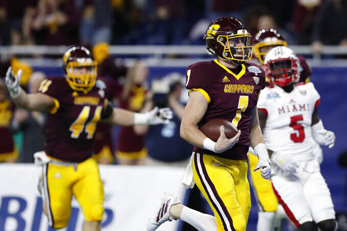 Central Michigan quarterback Tommy Lazzaro (7) runs for a touchdown during the first half of the Mid-American Conference championship NCAA college football game against Miami of Ohio, Saturday, Dec. 7, 2019, in Detroit. (AP Photo/Carlos Osorio)