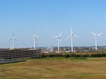 This Oct. 1, 2020 photo shows windmills at a utility plant in Atlantic City N.J. People who oppose the three offshore wind power projects approved off New Jersey's coast cite concerns about the environment and the economy, among others. (AP Photo/Wayne Parry)