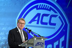 FILE - In this July 17, 2019, fil photo, Commissioner John Swofford speaks during the Atlantic Coast Conference NCAA college football media day in Charlotte, N.C. There are 130 major college football teams, spread across 41 states and competing in 10 conferences, save for a handful of independents. The goal is to have all those teams start the upcoming season at the same time — whether that's around Labor Day as scheduled or later — and play the same number of games. (AP Photo/Chuck Burton, File)