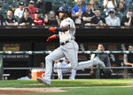 Houston Astros' Yordan Alvarez (44) runs home to score on a passed ball by Chicago White Sox catcher Welington Castillo (21) during the sixth inning of game one of a baseball doubleheader, Tuesday, Aug. 13, 2019, in Chicago. (AP Photo/David Banks)