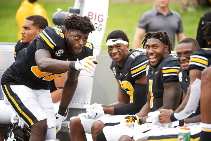 Missouri's Daniel Parker Jr., front left, jokes with teammates late in the fourth quarter of their victory over Central Michigan in an NCAA college football game Saturday, Sept. 4, 2021, in Columbia, Mo. (AP Photo/L.G. Patterson)