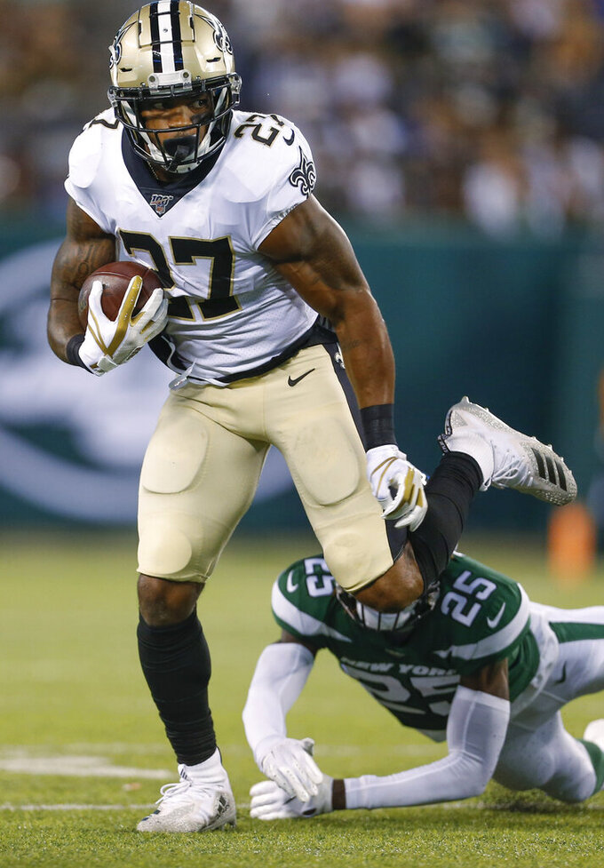 New Orleans Saints' Dwayne Washington (27) runs past New York Jets' Alex Brown (25) during the first half of a preseason NFL football game Saturday, Aug. 24, 2019, in East Rutherford, N.J. (AP Photo/Adam Hunger)