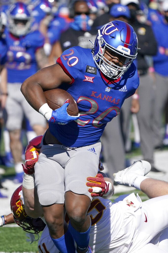 Kansas running back Daniel Hishaw Jr. (20) breaks a tackle and scores a touchdown during the first half of an NCAA college football game against Iowa State in Lawrence, Kan., Saturday, Oct. 31, 2020. (AP Photo/Orlin Wagner)