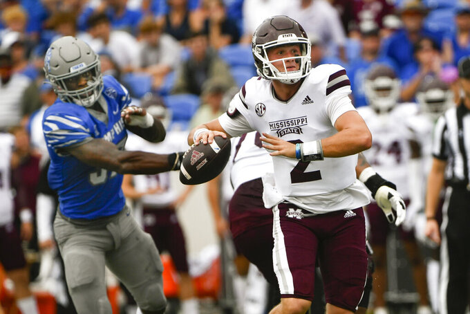 Mississippi State quarterback Will Rogers (2) looks to pass as Memphis defensive lineman Jaylon Allen (37) pressures him during the first half of an NCAA football game on Saturday, Sept. 18, 2021, in Memphis, Tenn. (AP Photo/John Amis)