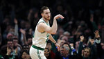 Boston Celtics forward Gordon Hayward (20) gestures after hitting a three-point basket during the first quarter of an NBA basketball game against the Brooklyn Nets in Boston, Monday, Jan. 7, 2019. (AP Photo/Charles Krupa)
