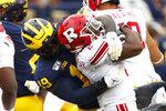 Michigan defensive lineman Kwity Paye (19) stops Rutgers running back Raheem Blackshear (2) in the first half of an NCAA college football game in Ann Arbor, Mich., Saturday, Sept. 28, 2019. (AP Photo/Paul Sancya)