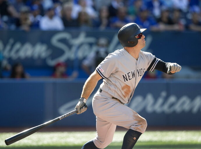 New York Yankees' Brett Gardner hits a home run against the Toronto Blue Jays in the fourth inning of a baseball game in Toronto, Saturday, Sept. 14, 2019. (Fred Thornhill/The Canadian Press via AP)