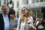 Toni Natalie, second from left, and Catherine Oxenberg talk with the media outside Brooklyn federal court after NXIVM defendant Keith Raniere was found guilty on all counts, Wednesday, June 19, 2019 in New York. Natalie is a former member of NXIVM and Oxenberg's daughter was a member of NXIVM. (AP Photo/Mark Lennihan)