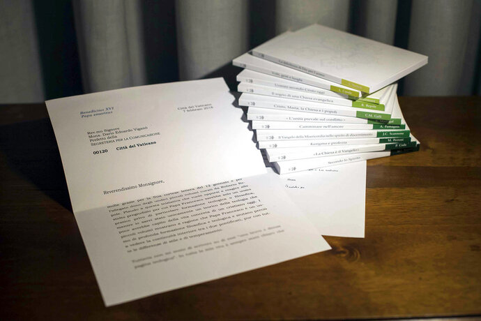 In this photo of a letter released by Vatican Media, retired Pope Benedict XVI praises a volume of books about the theological training of Pope Francis. The Vatican admitted Thursday, March 14, 2018 that it blurred the final two lines of the letter's first page, where Benedict begins to acknowledge that he didn't read the books and doesn't have time to write a theological assessment of Francis as requested. (Vatican Media photo via AP)