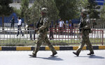 FILE- in this Thursday, Sept. 5, 2019 file photo, British soldiers with NATO-led Resolute Support Mission forces arrive at the site of a car bomb explosion in Kabul, Afghanistan, (AP Photo/Rahmat Gul, file)