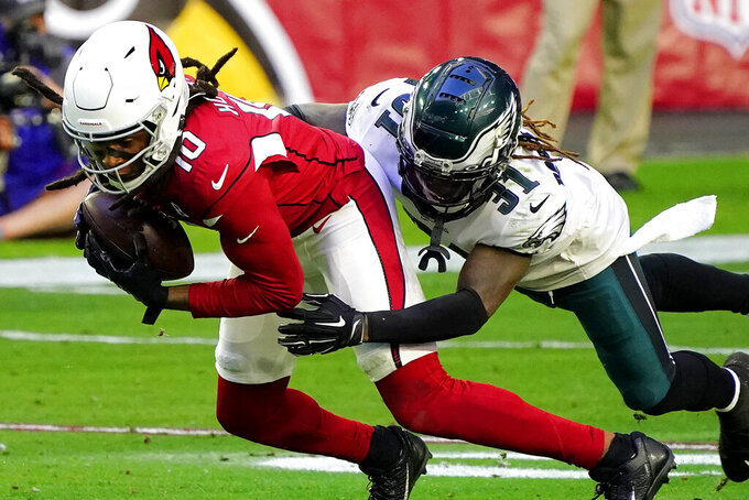 Arizona Cardinals wide receiver DeAndre Hopkins (10) is hit by Philadelphia Eagles cornerback Nickell Robey-Coleman (31) during the first half of an NFL football game, Sunday, Dec. 20, 2020, in Glendale, Ariz. (AP Photo/Rick Scuteri)