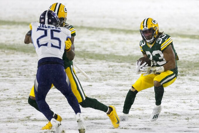 Green Bay Packers' Aaron Jones runs before an NFL football game against the Tennessee Titans Sunday, Dec. 27, 2020, in Green Bay, Wis. (AP Photo/Matt Ludtke)