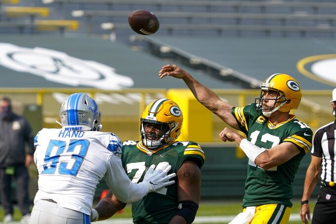 Green Bay Packers' Aaron Rodgers throws during the second half of an NFL football game against the Detroit Lions Sunday, Sept. 20, 2020, in Green Bay, Wis. (AP Photo/Morry Gash)