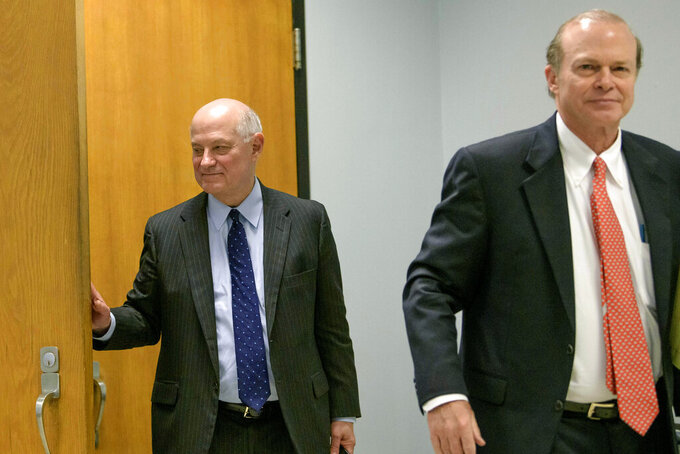 "Edward Dirk Wegmann, attorney for the New Orleans Archdiocese, right, and James C. Gulotta, Jr., attorney for the New Orleans Saints, leave a hearing at Orleans Parish Civil District Court in New Orleans, Thursday, Feb. 20, 2020.  The New Orleans Saints headed to court Thursday in a bid to block the release of hundreds of confidential emails detailing the behind-the-scenes public relations work the team did for the area's Roman Catholic archdiocese amid its sexual abuse crisis. The request comes amid claims that the NFL team joined the Archdiocese of New Orleans in a ""pattern and practice"" of concealing sexual abuse — an allegation the Saints have vehemently denied.    (AP Photo/Matthew Hinton)"