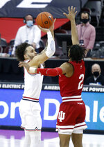 Ohio State guard Duane Washington, left, goes up for a shot against Indiana guard Armaan Franklin during the first half of an NCAA college basketball game in Columbus, Ohio, Saturday, Feb. 13, 2021. (AP Photo/Paul Vernon)