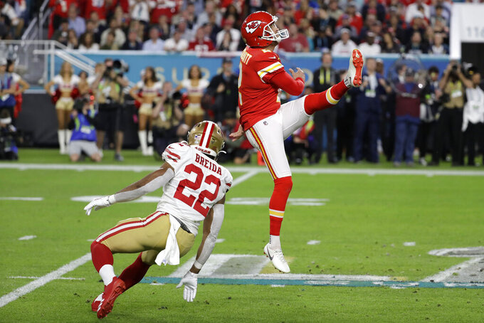 FILE - Then-Kansas City Chiefs punter Dustin Colquitt (2) punts the ball during the first half of the NFL Super Bowl 54 football game Sunday, Feb. 2, 2020, in Miami Gardens, Fla. Pittsburgh signed Colquitt on Monday, Sept. 7, 2020, and he will be in uniform when the Steelers open at the New York Giants on Sept. 14. It was the highest-profile of a series of roster moves Pittsburgh made in hopes of chasing down defending AFC North champion Baltimore.(AP Photo/Seth Wenig, File)