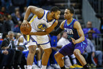 Golden State Warriors forward Omari Spellman, left, looks to pass the ball as Charlotte Hornets forward P.J. Washington defends during the first half of an NBA basketball game in Charlotte, N.C., Wednesday, Dec. 4, 2019. (AP Photo/Nell Redmond)