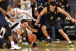 Georgia Tech guard Jose Alvarado (10) and Pittsburgh guard Trey McGowens (2) reach for a loose ball during the first half of an NCAA college basketball game Wednesday, Feb. 20, 2019, in Atlanta. (AP Photo/Danny Karnik)