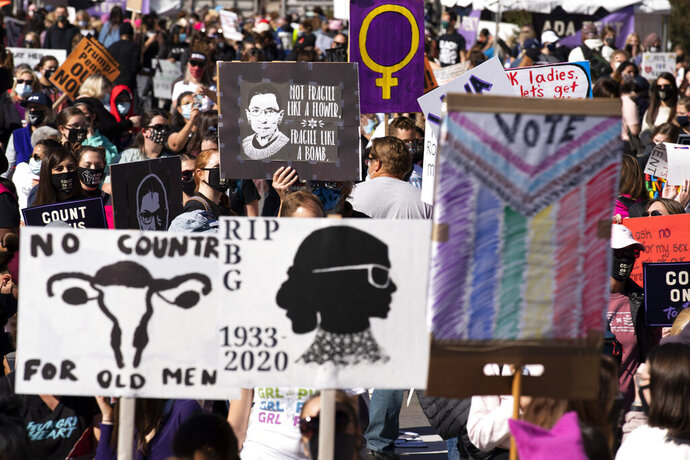 Demonstrators rally during the Women's March at Freedom Plaza, Saturday, Oct. 17, 2020, in Washington. (AP Photo/Jose Luis Magana)