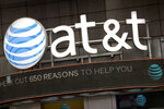 FILE - In this Monday, Oct. 24, 2016, file photo, the AT&T logo is positioned above one of its retail stores, in New York. A federal appeals court on Tuesday, Feb. 26, 2019 upheld AT&T's $81 billion takeover of Time Warner, approving one of the biggest media deals on record in the face of opposition from the Trump administration. The combination of one of the country's largest wireless carriers and TV providers with a major TV and movie company has already reshaped the media landscape. (AP Photo/Mark Lennihan, File)
