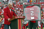Former Tampa Bay Buccaneers defensive coordinator Monte Kiffin speaks to the crowd after being inducted into the Buccaneer's Ring of Honor during halftime of an NFL football game against the Atlanta Falcons Sunday, Sept. 19, 2021, in Tampa, Fla. (AP Photo/Mark LoMoglio)