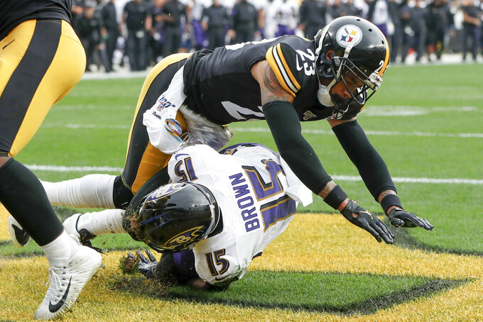 Baltimore Ravens wide receiver Marquise Brown (15) makes a touchdown catch in front of Pittsburgh Steelers cornerback Joe Haden (23) in the first half of an NFL football game against the Baltimore Ravens Sunday, Oct. 6, 2019, in Pittsburgh. (AP Photo/Don Wright)