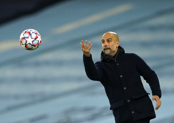 FILE - In this file photo dated Tuesday, Nov. 3, 2020, Manchester City's head coach Pep Guardiola during the Champions League group C soccer match against Olympiacos at the Etihad stadium in Manchester, England. Manchester City said Thursday Nov. 19, 2020, that manager Pep Guardiola has signed a two-year contract extension, keeping Pep at the English club until the end of the 2022-23 season. (AP Photo/Dave Thompson, FILE)
