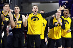 Iowa players celebrate after guard Jordan Bohannon scored a basket against Northwestern during the second half of an NCAA college basketball game Wednesday, Jan. 9, 2019, in Evanston, Ill. Iowa won 73-63. (AP Photo/Nam Y. Huh)