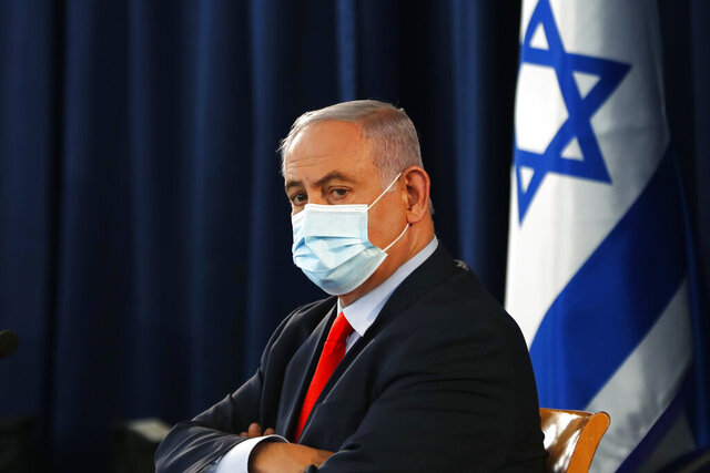 Israeli Prime Minister Benjamin Netanyahu wears a mask as he looks on during the weekly cabinet meeting in Jerusalem Saturday, May 31, 2020. (Ronen Zvulun/Pool Photo via AP)