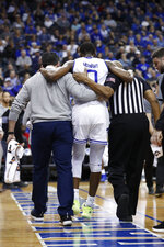 Seton Hall's Quincy McKnight (0) is assisted off of the court after being injured against Xavier's Tyrique Jones  during the second half of an NCAA college basketball game, Saturday, feb. 1, 2020, in Newark, N.J. Xavier won, 74-62. (AP Photo/Michael Owens)