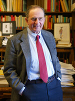 """History Professor Bernard Bailyn poses in his Harvard University office in Cambridge, Mass., Feb. 26, 2003. Bailyn, one of the country's leading historians of the early U.S., has died at age 97. Bailyn was best known for his Pulitzer Prize-winning """"The Ideological Origins of the American Revolution,"""" among the most influential historical works of the past few decades. (AP Photo/Julia Malakie, File)"""