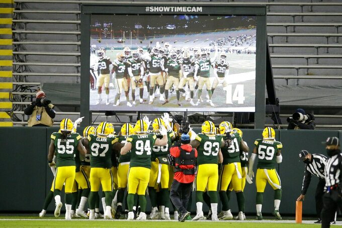 Green Bay Packers players help Darnell Savage celebrate his interception in the end zone during the first half of an NFL football game against the Chicago Bears Sunday, Nov. 29, 2020, in Green Bay, Wis. (AP Photo/Mike Roemer)